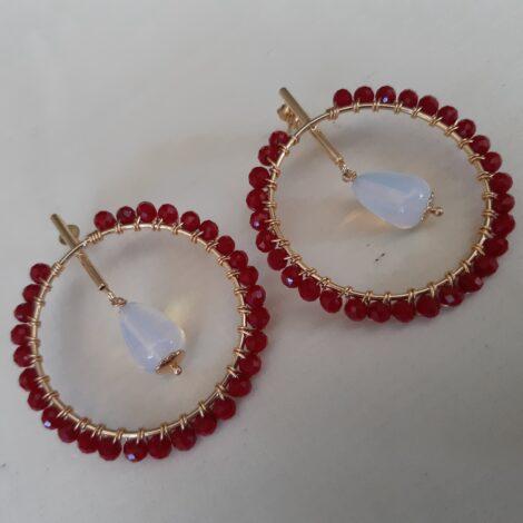 Aretes goldfilled con cristales rojos y ópalo