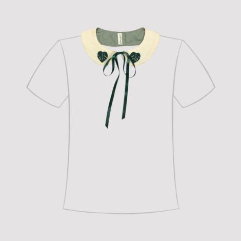 cuello de quita y pon en manta sucia con forro, lazo de cierre y monsteras en línea de camiseta
